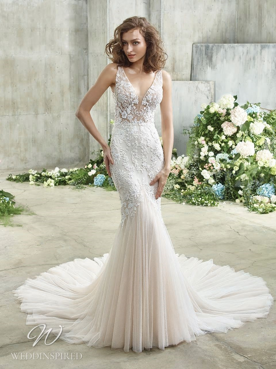 A Badgley Mischka lace mermaid wedding dress with a tulle skirt and a v neckline