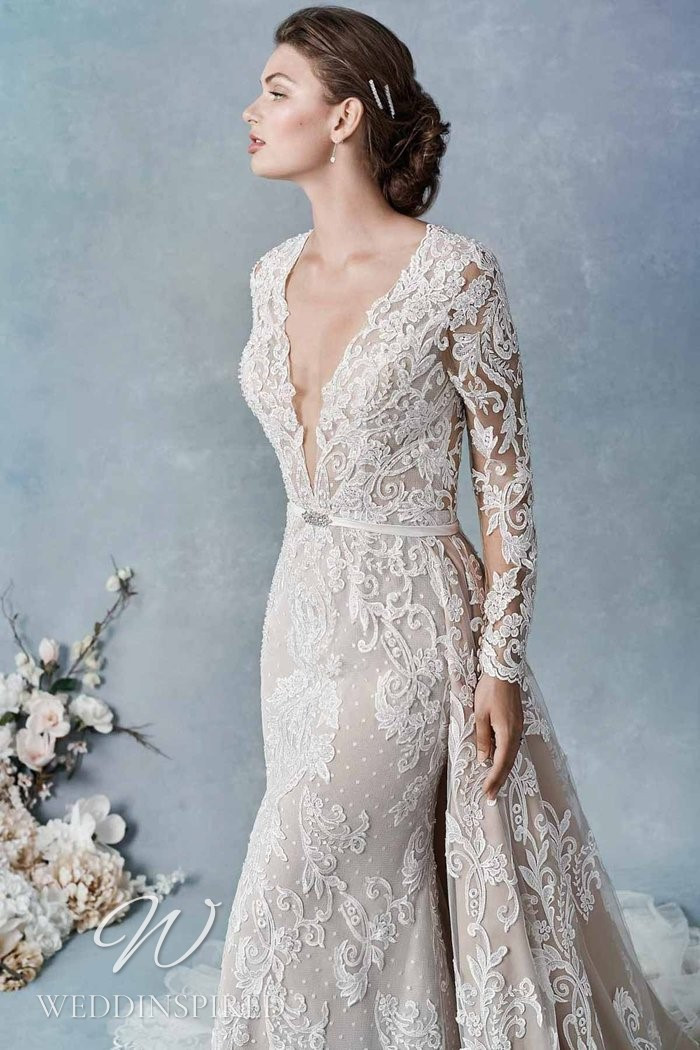 A Kenneth Winston 2021 lace mermaid wedding dress with long sleeves and a v neck