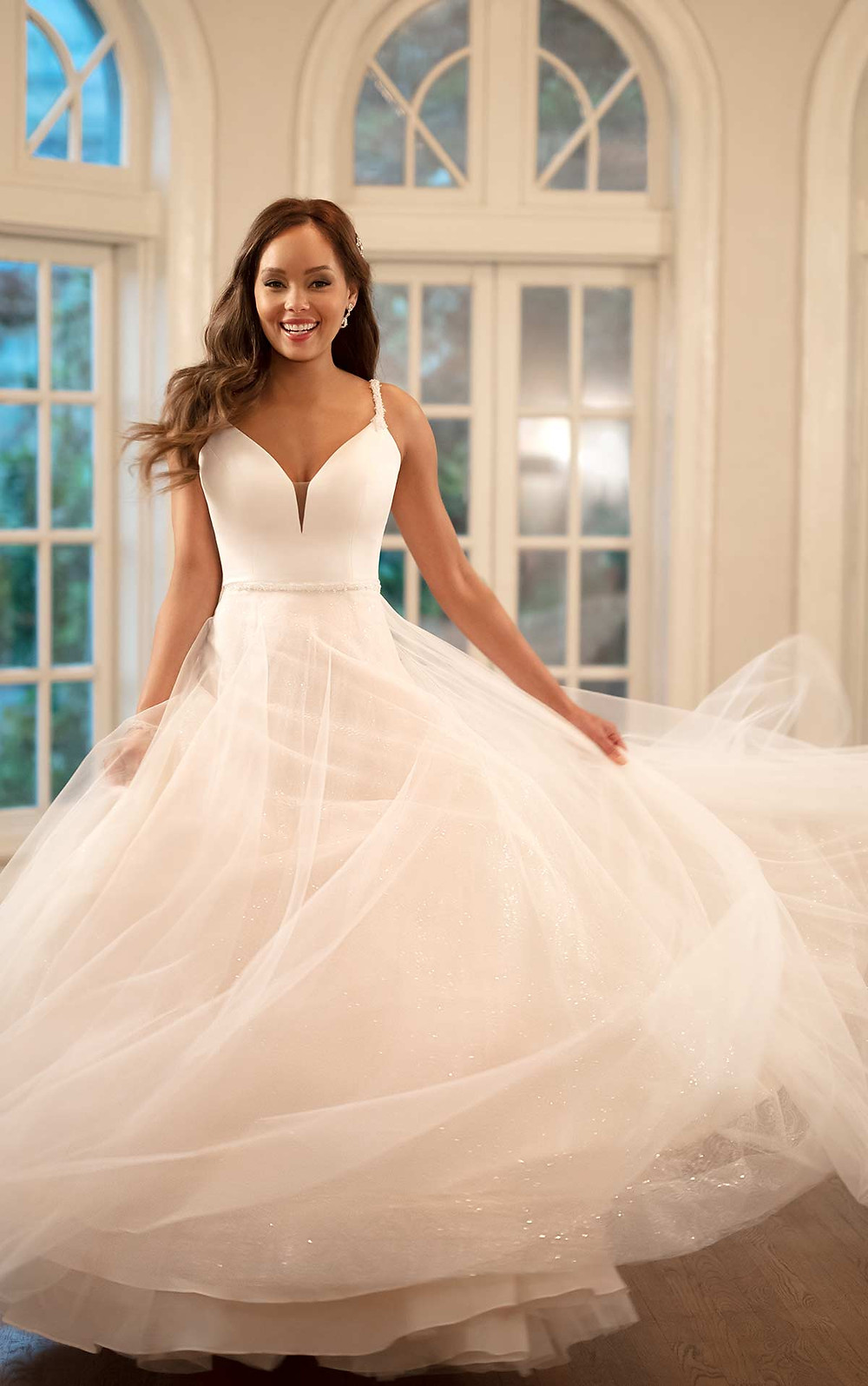 A Stella York 2020 blush crepe and tulle ball gown wedding dress with straps