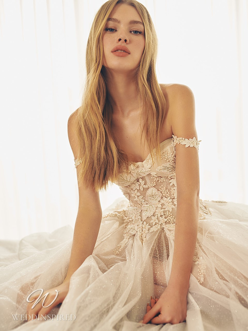 A Galia Lahav 2022 blush off the shoulder lace and tulle A-line wedding dress
