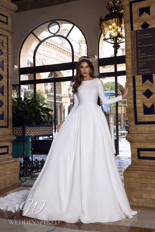 A Maks Mariano modest satin princess wedding dress with long sleeves