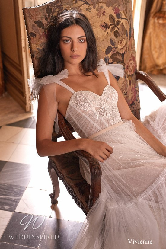 A Gali Karten tulle layered A-line wedding dress with bow straps