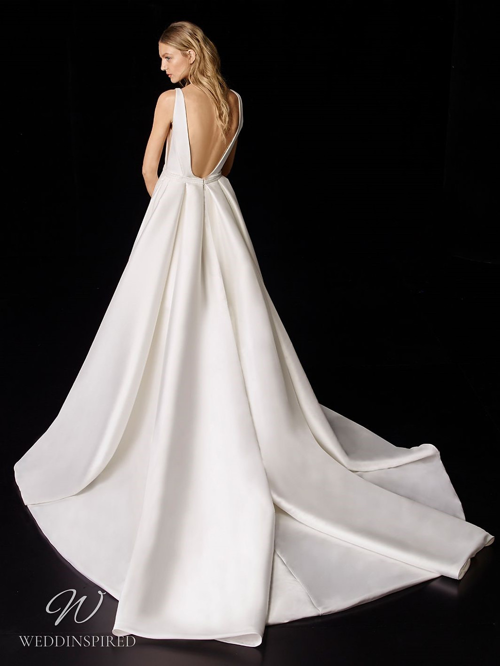 An Enzoani silk ball gown wedding dress with a low back