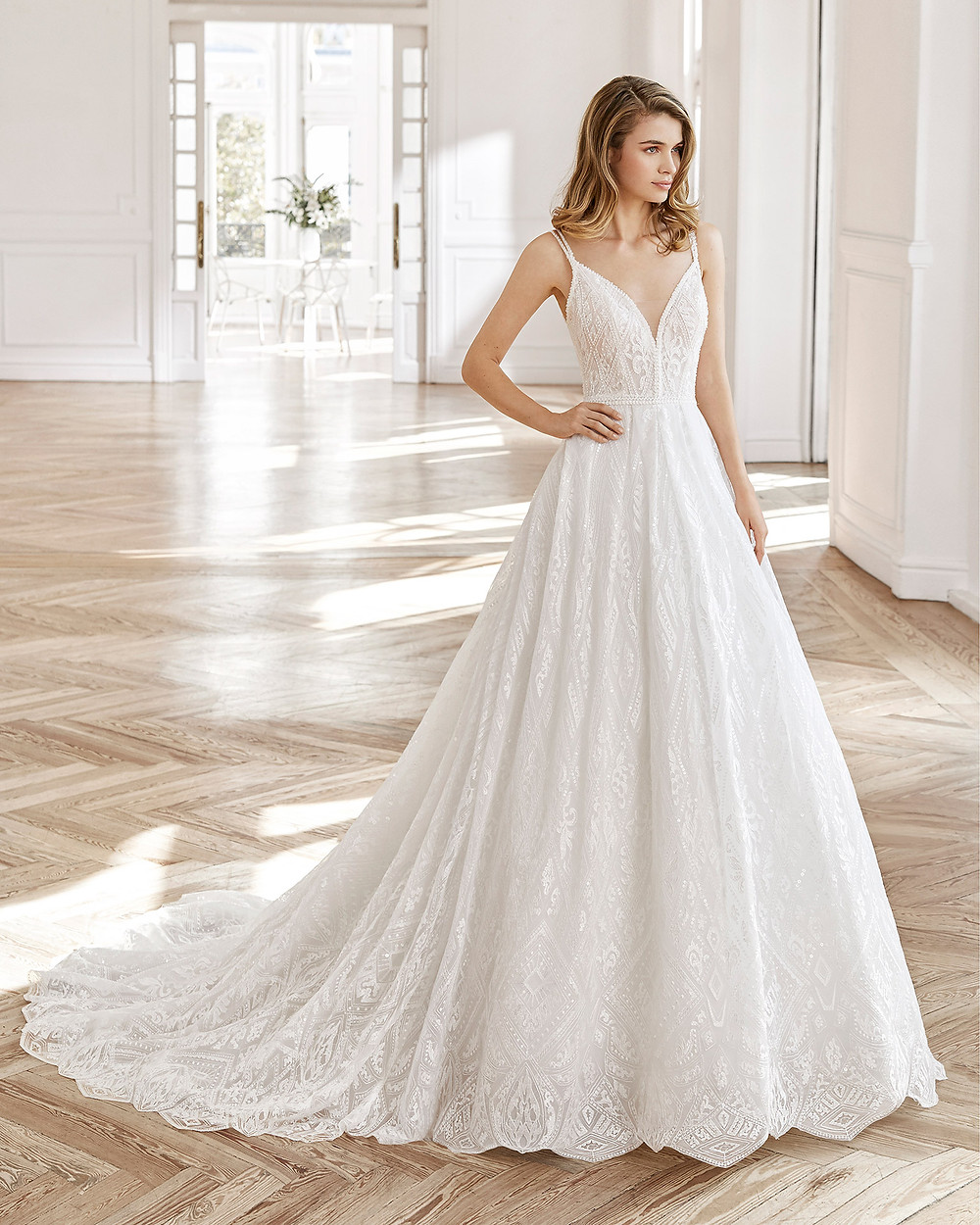 An Aire Barcelona 2020 lace A-line wedding dress with straps and a v neckline
