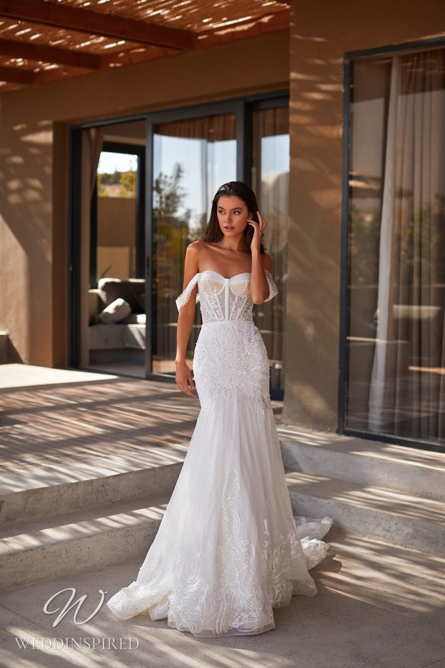 A Milla by Lorenzo Rossi 2021/2022 off the shoulder lace and satin mermaid wedding dress with a train
