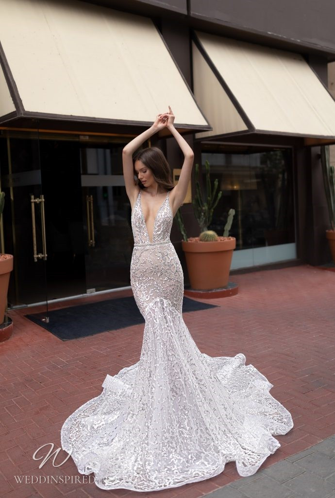 An Eden Aharon 2020 sparkly mesh mermaid fit and flare wedding dress with straps and a v neckline
