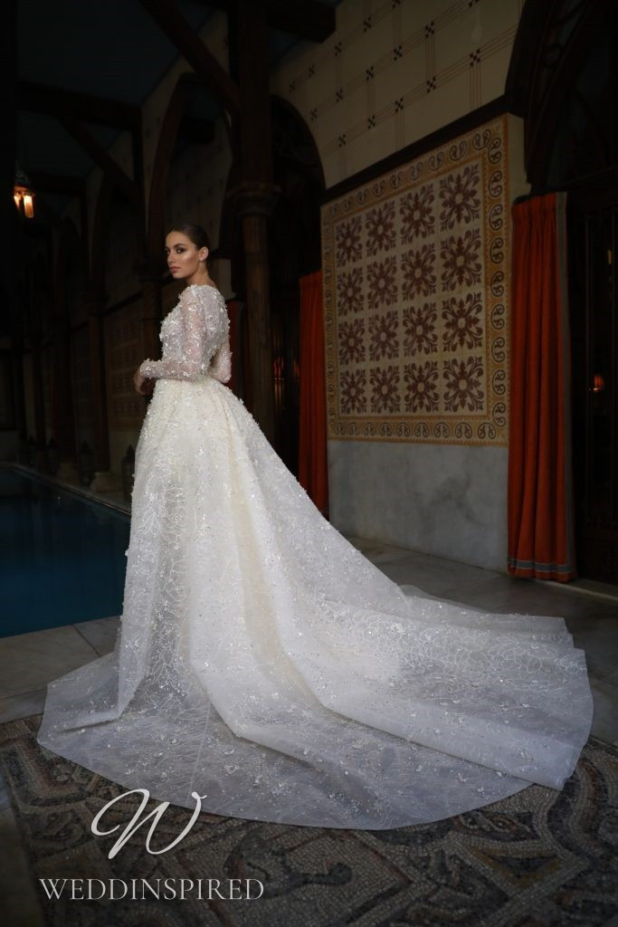 A Georges Hobeika 2021 lace mermaid wedding dress with a v neck and long sleeves