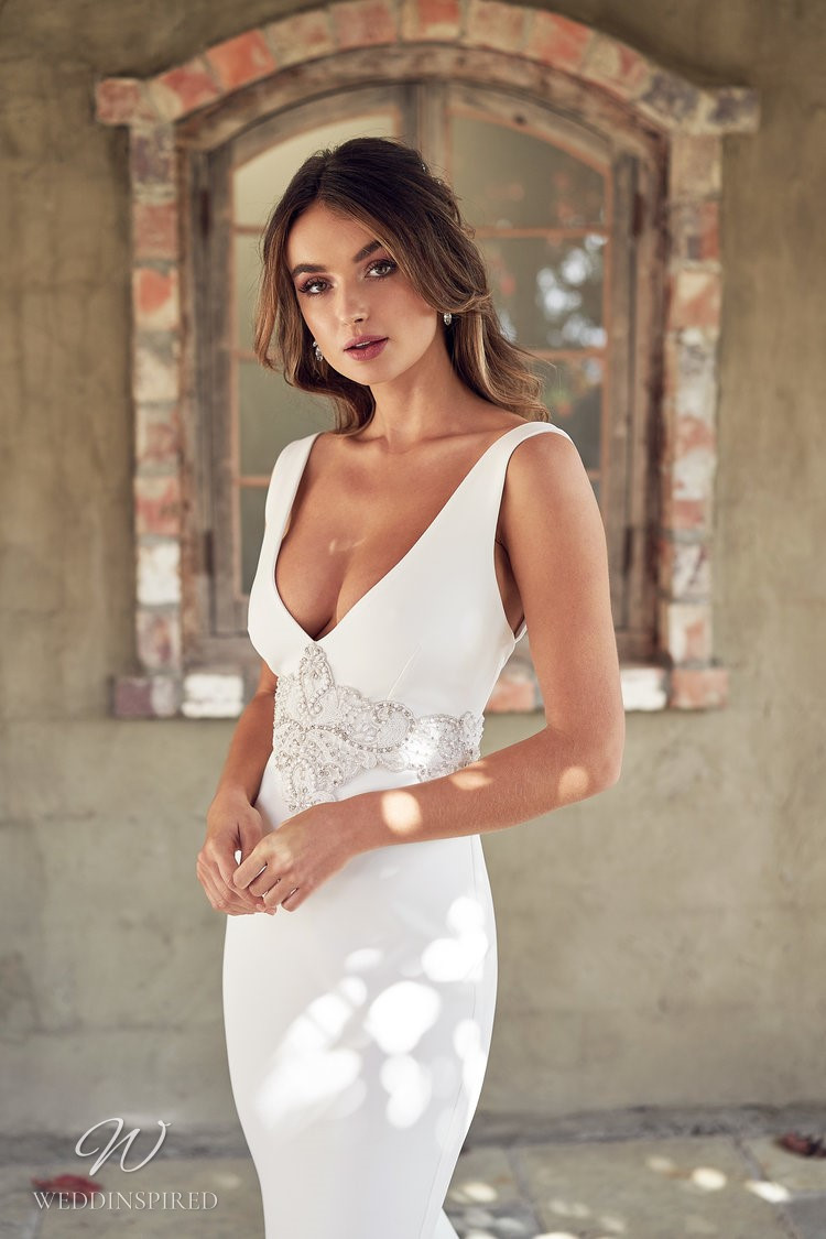 An Anna Campbell 2020 fitted v neck wedding dress with beading and crystals