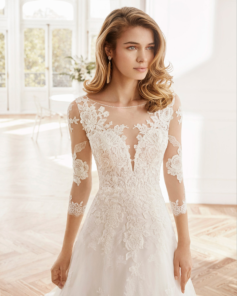 An Aire Barcelona 2020 lace A-line wedding dress with an illusion neckline and long lace illusion sleeves