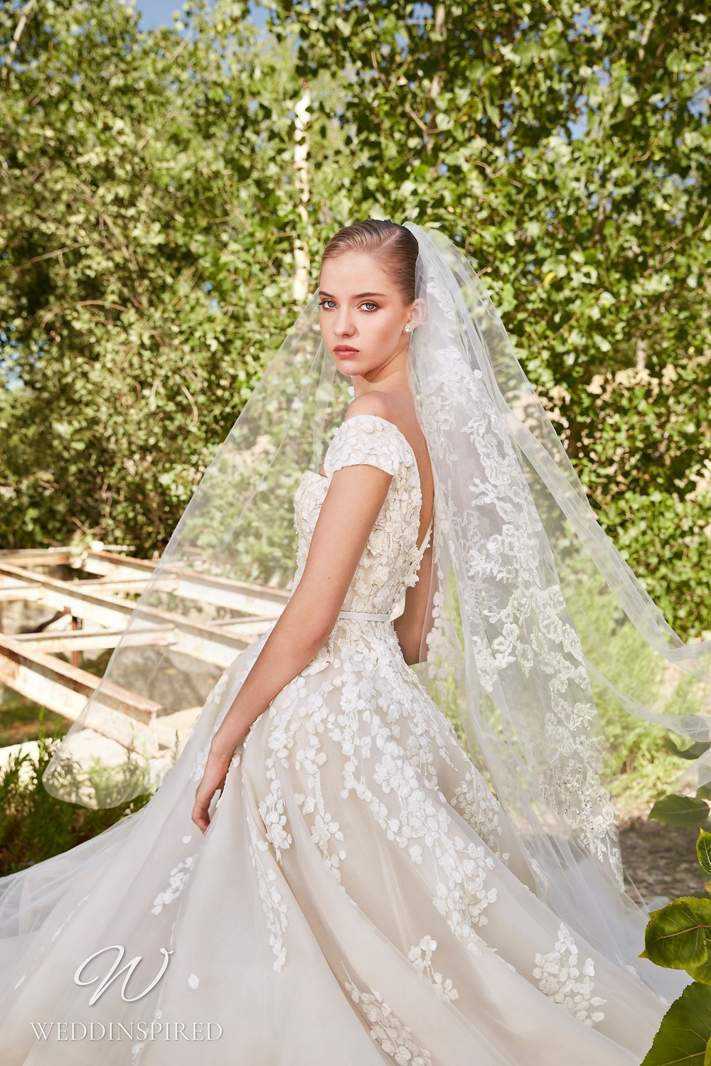 An Elie Saab Spring 2021 lace and mesh princess ball gown wedding dress with thick straps