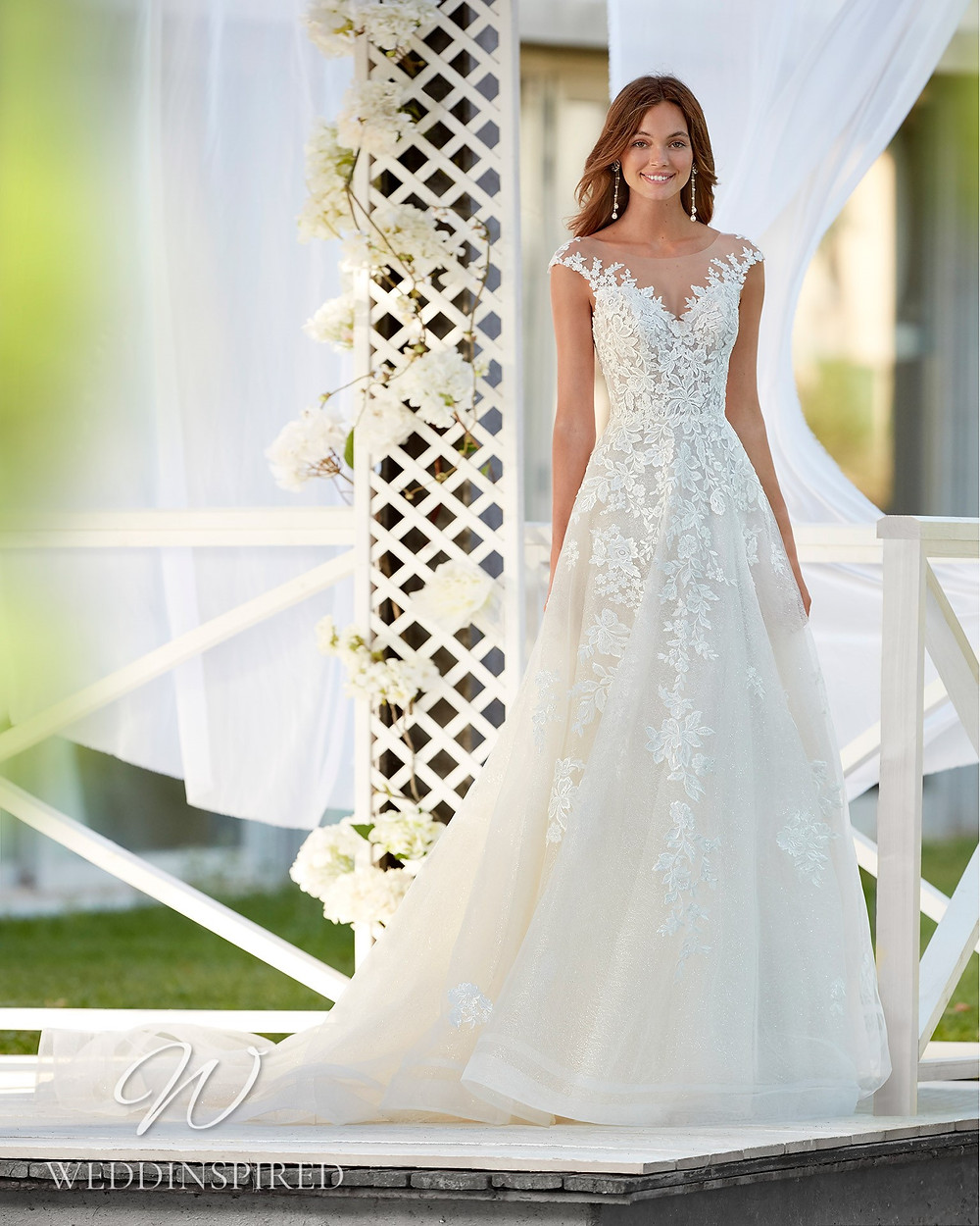 An Aire Barcelona 2021 off the shoulder lace A-line wedding dress