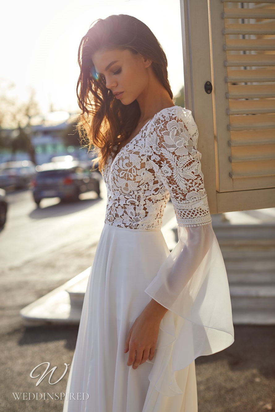 A Milla Nova 2021 lace and chiffon A-line wedding dress with long sleeves and a v neck