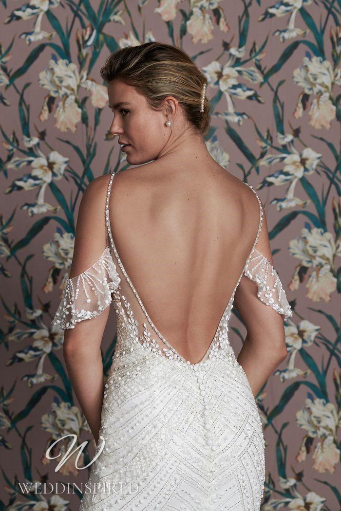A Justin Alexander 2021 off the shoulder beaded mermaid wedding dress
