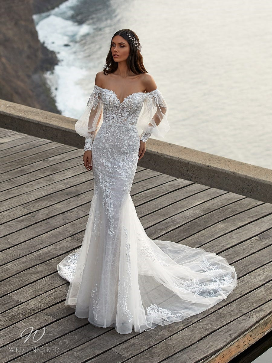 A Pronovias 2021 off the shoulder lace and mesh mermaid wedding dress with long sleeves