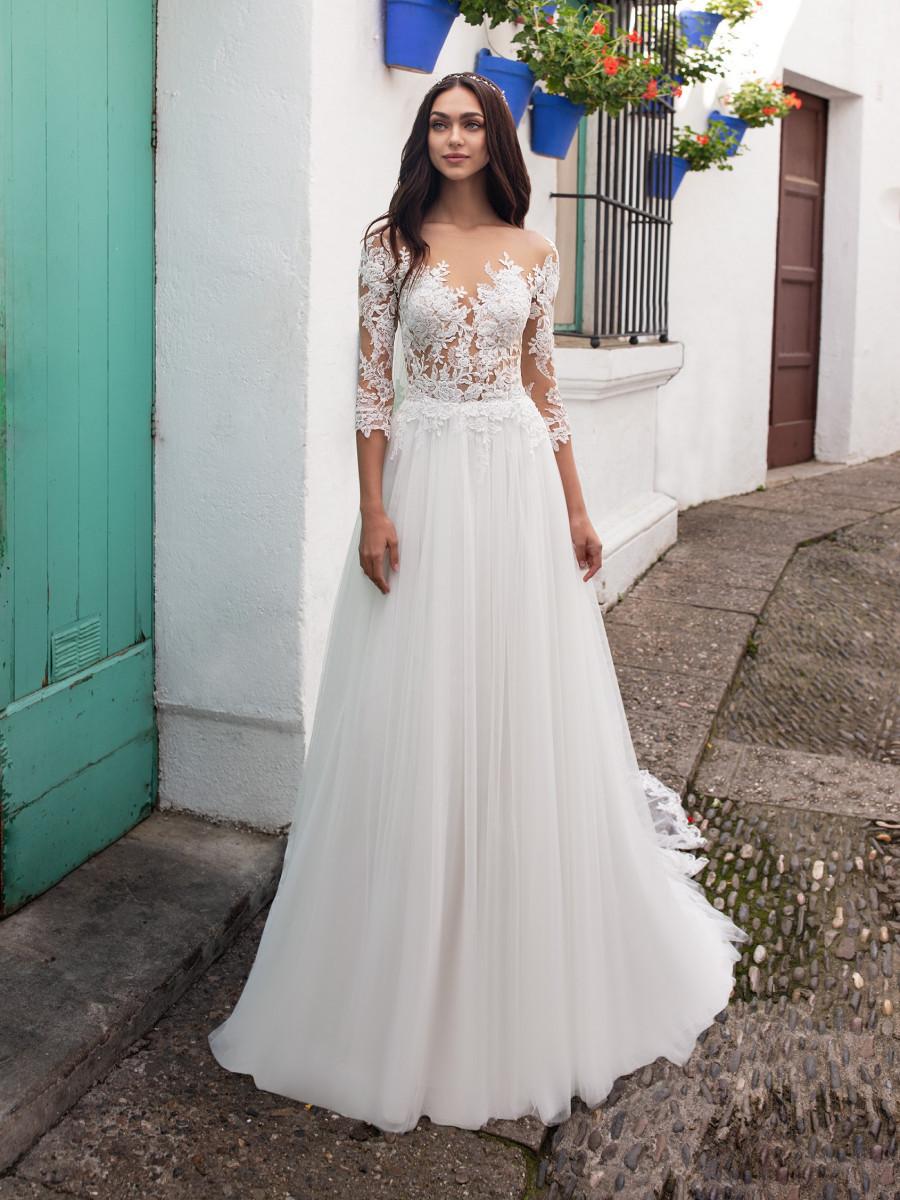 A Pronovias 3/4 sleeve, A-line wedding dress, with lace top and a chiffon skirt