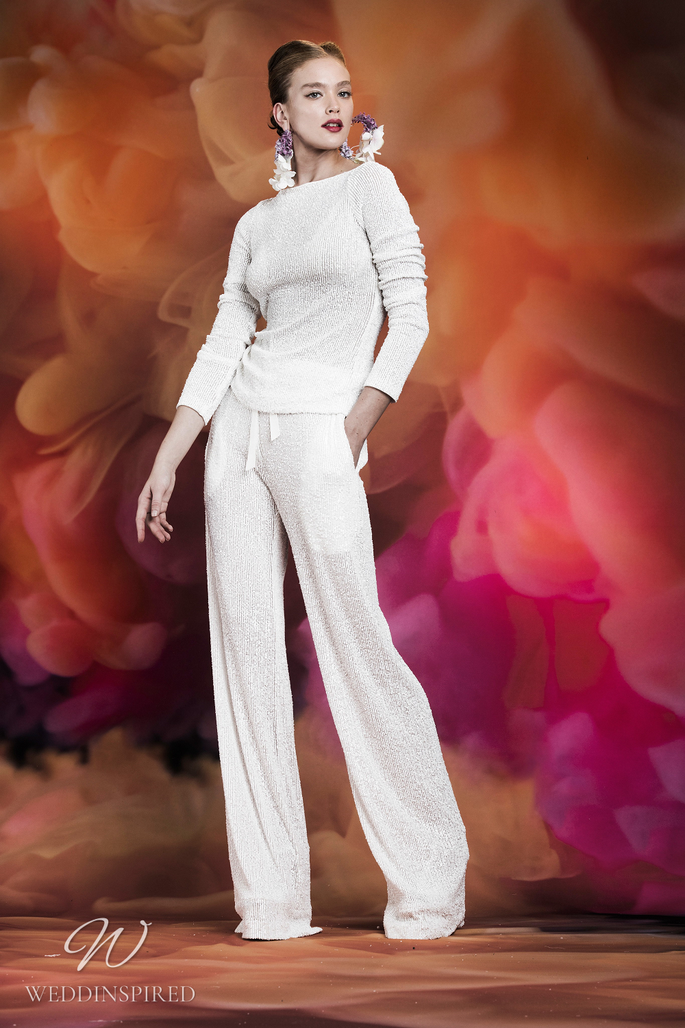 A Naeem Khan wedding jumpsuit or pantsuit with long sleeves and pockets