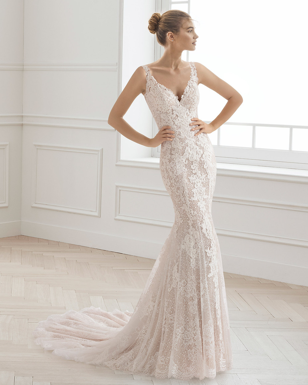 An Aire Barcelona 2020 blush lace mermaid wedding dress with a v neck