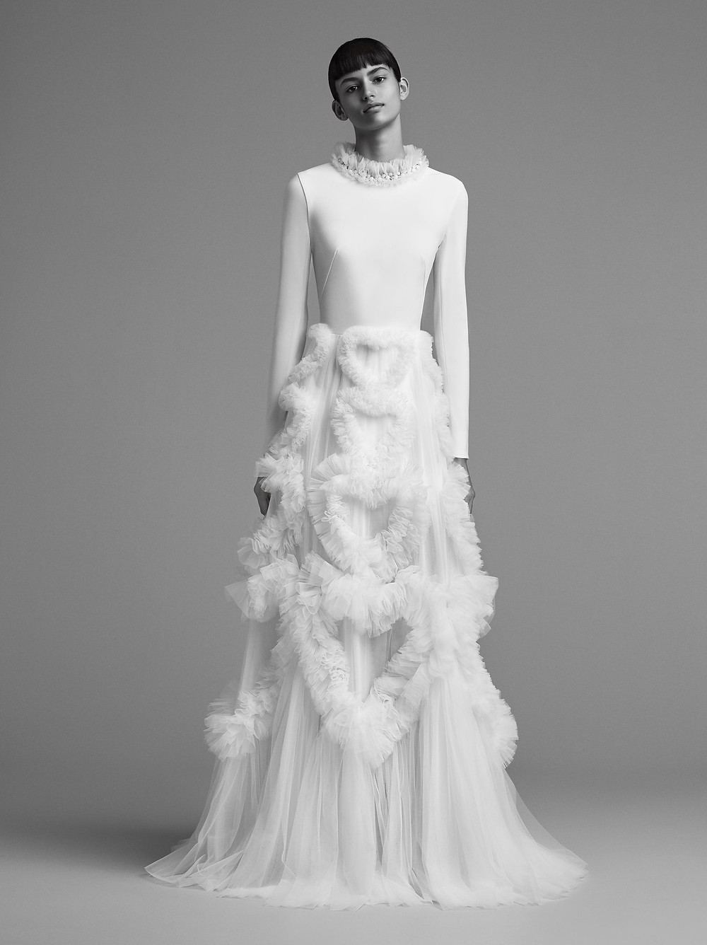 A  Viktor & Rolf modest tulle A-line wedding dress with long sleeves and a high neckline