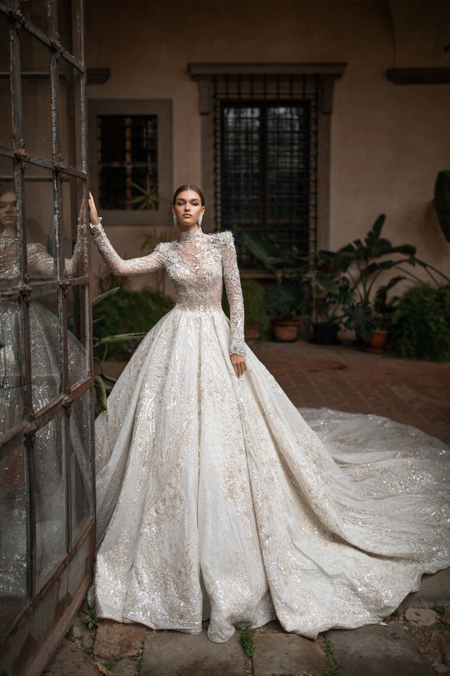 A Milla Nova modest sparkly princess ball gown wedding dress with long sleeves