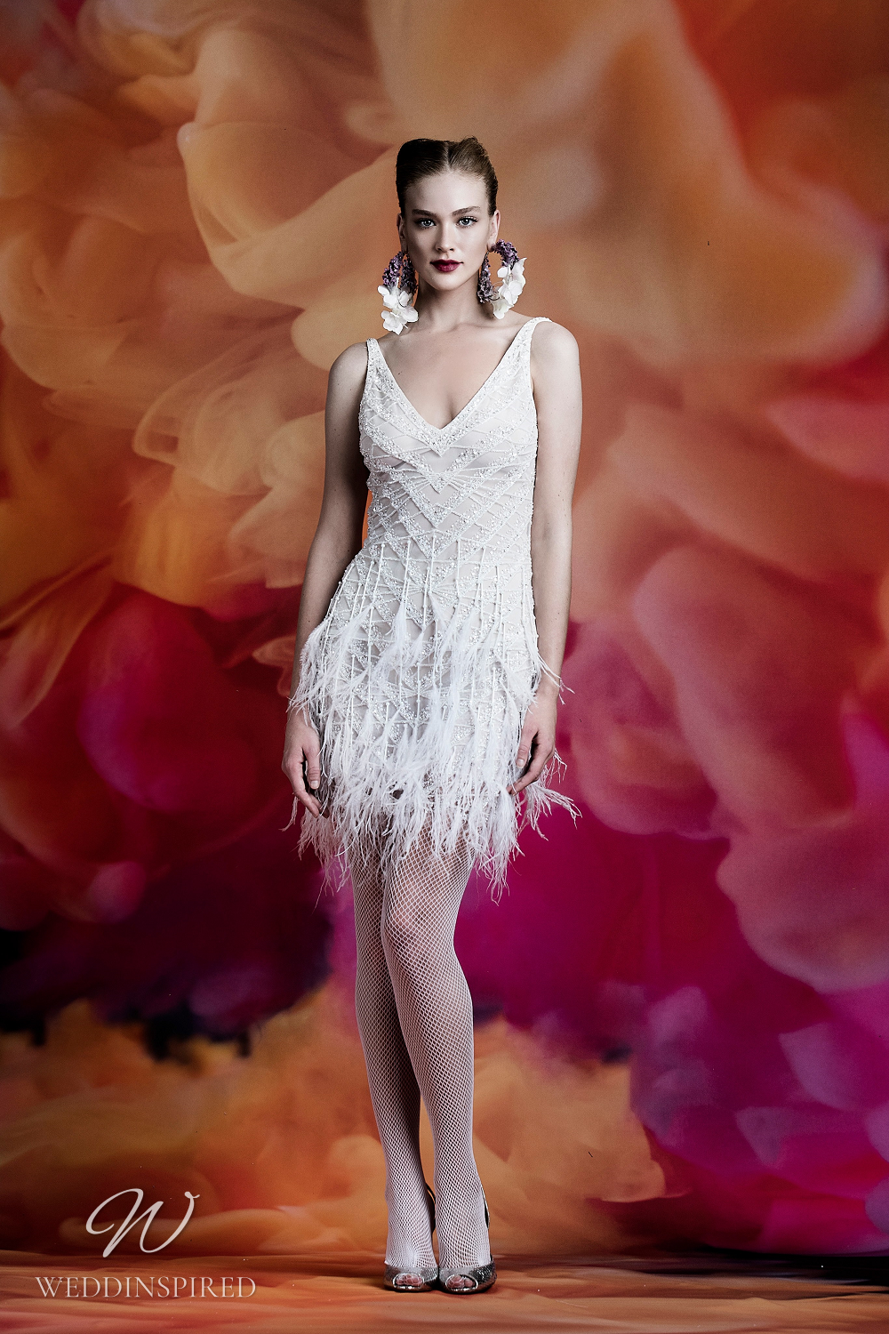 A Naeem Khan short wedding dress with feathers, straps and a v neckline