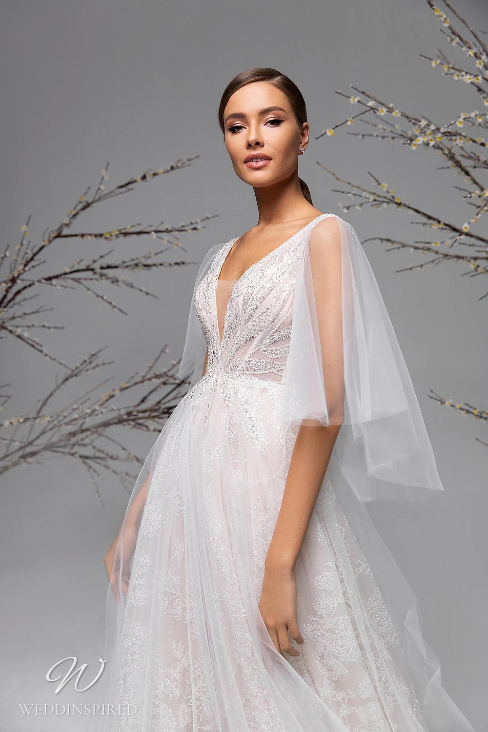 A Ricca Sposa lace and mesh A-line wedding dress