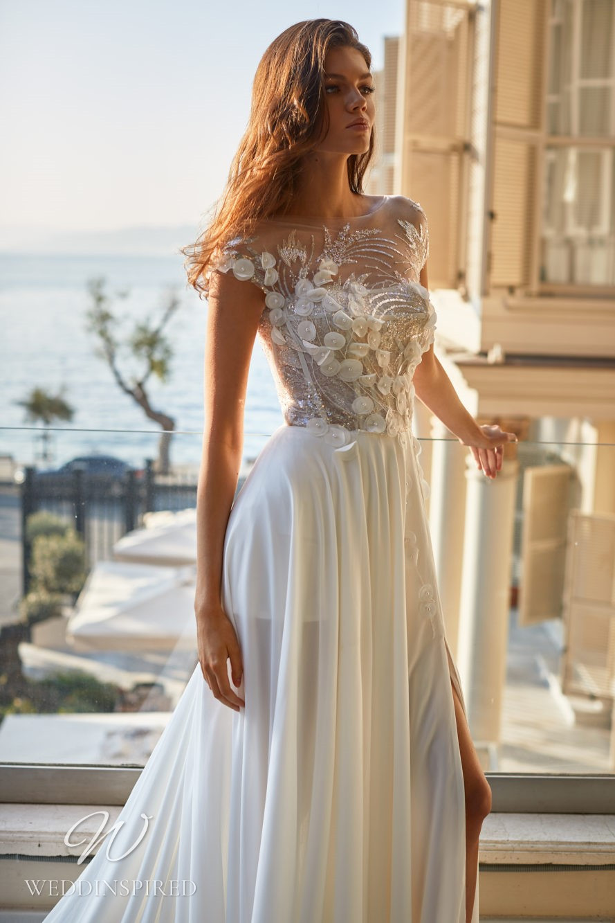 A Milla Nova 2021 ivory lace and chiffon A-line wedding dress with cap sleeves and an illusion bodice