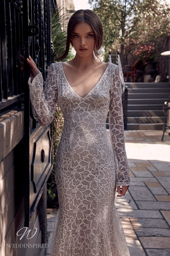 A Julie Vino 2021 lace mermaid wedding dress with long sleeves and a v neckline