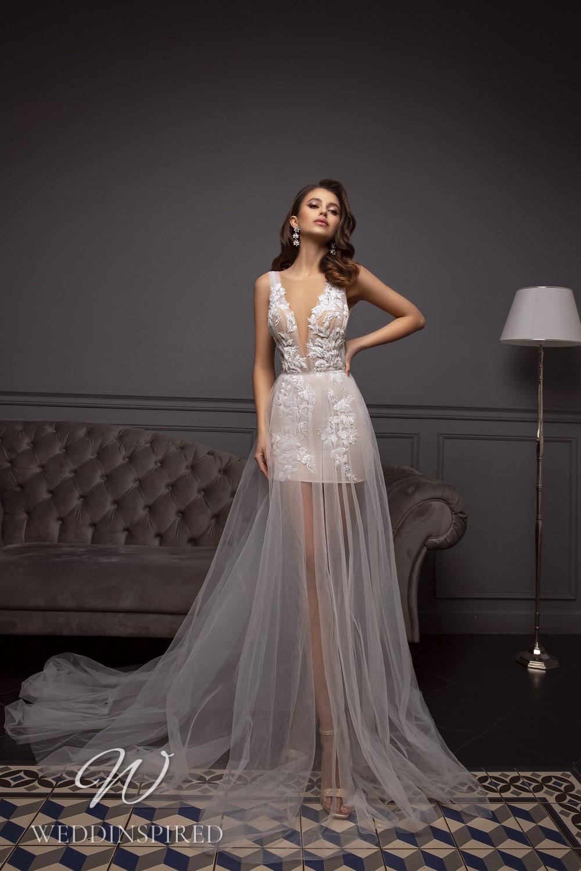 A Tina Valerdi lace and tulle short wedding dress