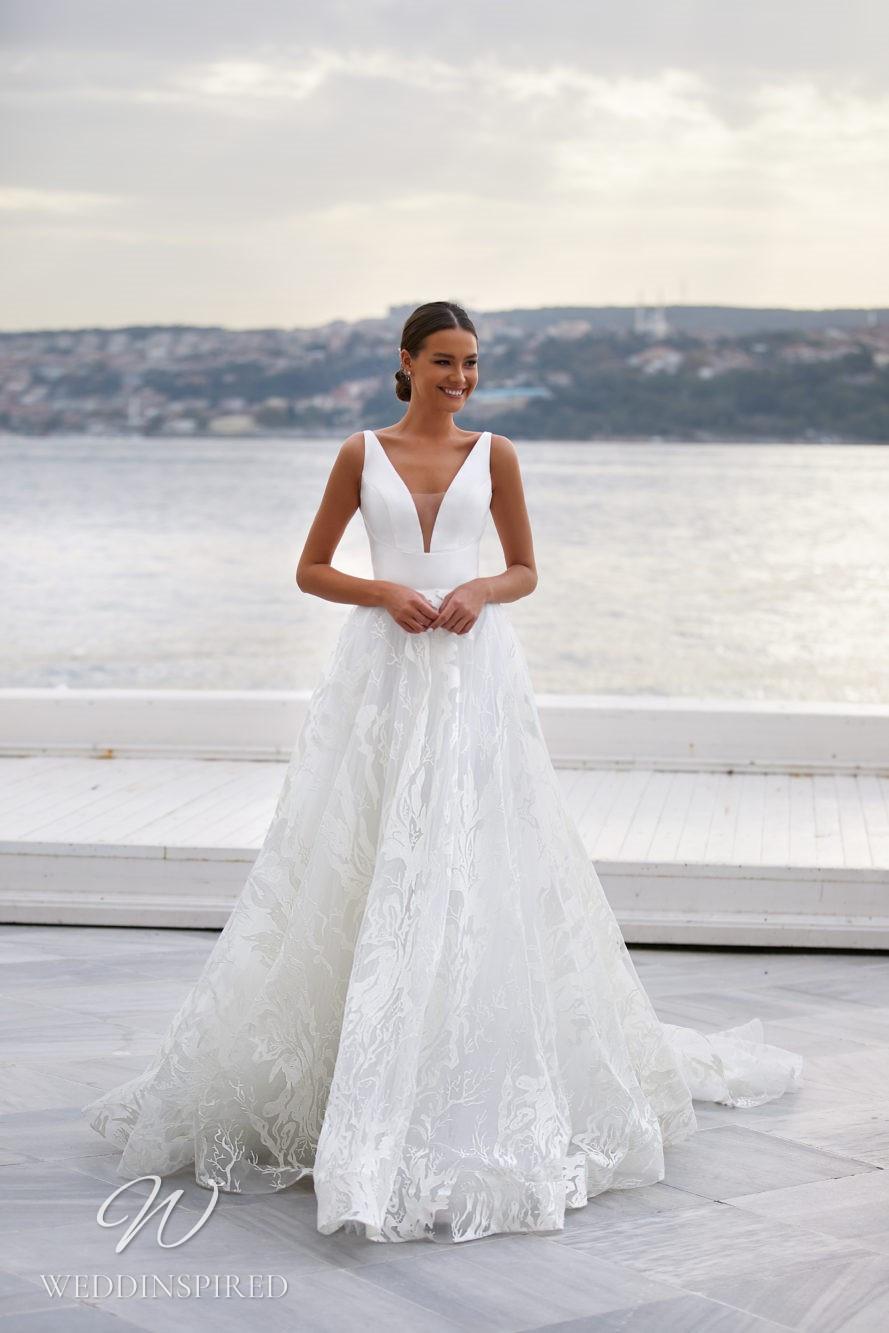 A Milla Nova 2021 satin A-line wedding dress with floral print, a v neck and straps