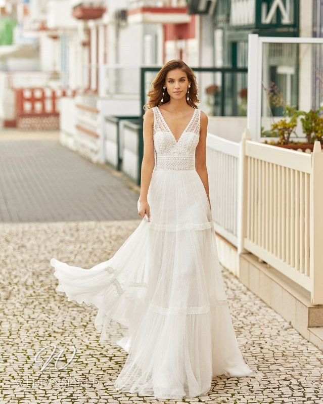 A Rosa Clara 2021 boho lace and tulle A-line wedding dress with a v neck