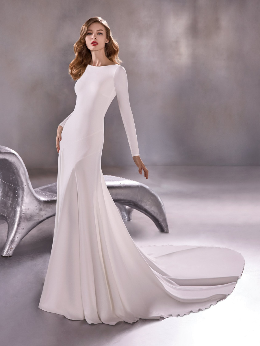 A Atelier Pronovias simple modest fit and flare wedding dress with long sleeves