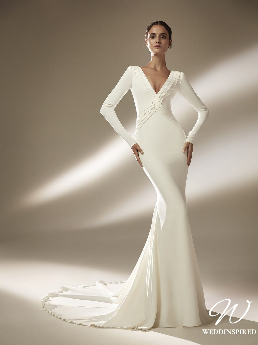 An Atelier Pronovias low v neck, silk mermaid wedding dress with long sleeves and a train