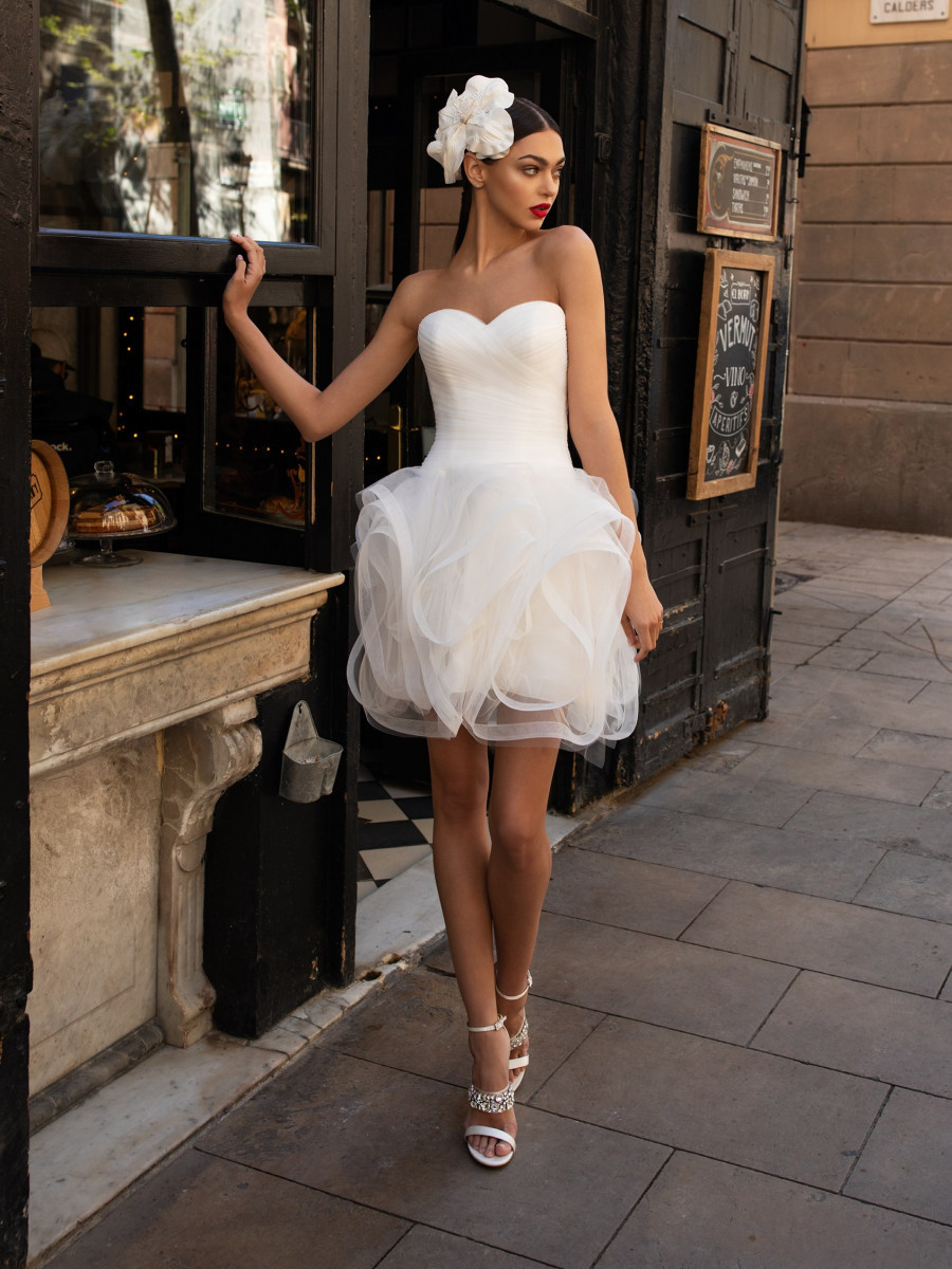 A Pronovias strapless short crepe and tulle wedding dress with a ruffle skirt