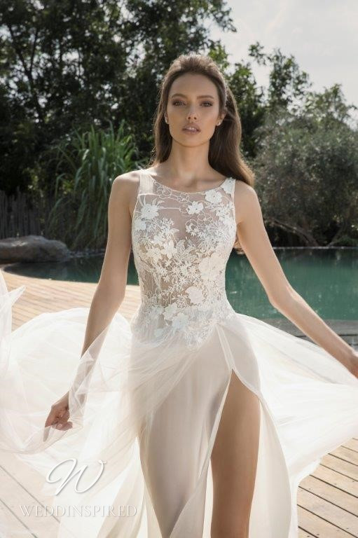 A David Hasbani lace and tulle A-line wedding dress with a high neckline