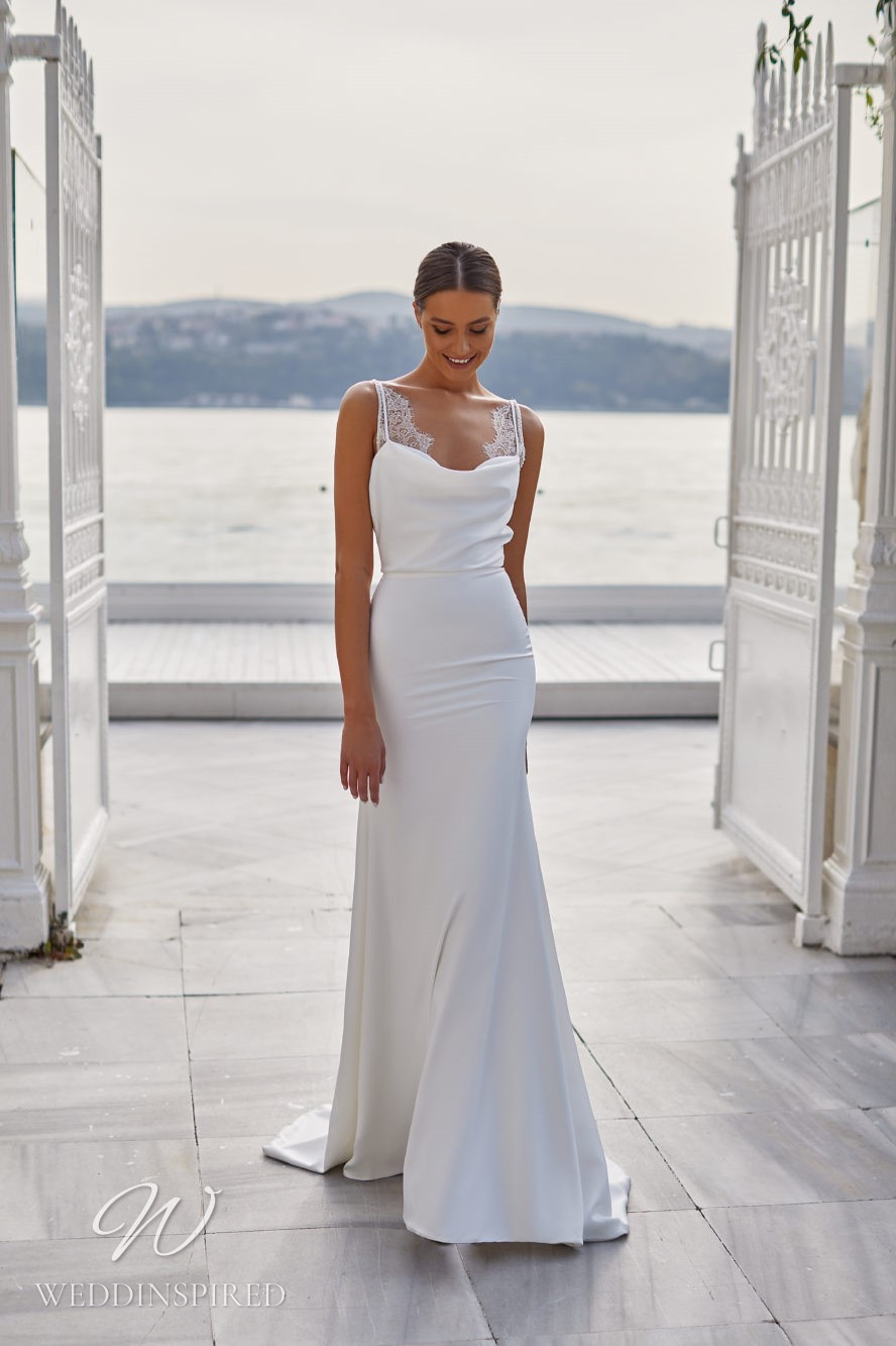 A Milla Nova 2021 satin and lace mermaid wedding dress with straps and a cowl neck