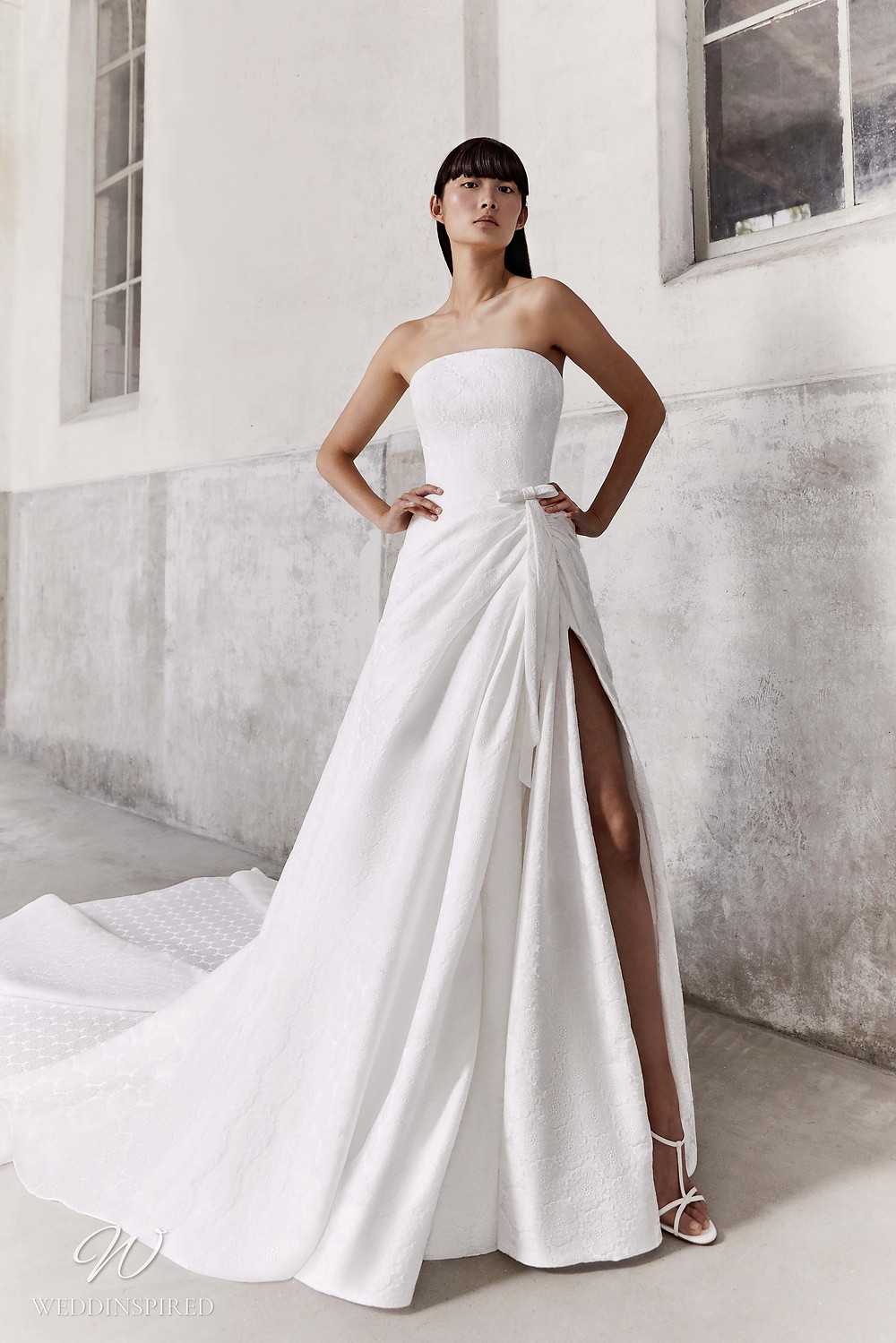 A Viktor & Rolf Fall/Winter 2021 simple strapless A-line wedding dress with a train and a high slit