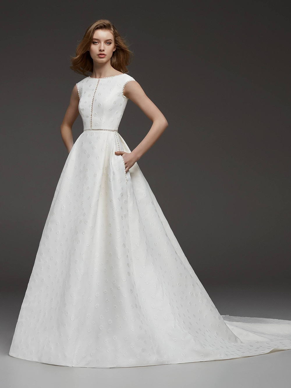 A Pronovias simple crepe ball gown wedding dress with pockets