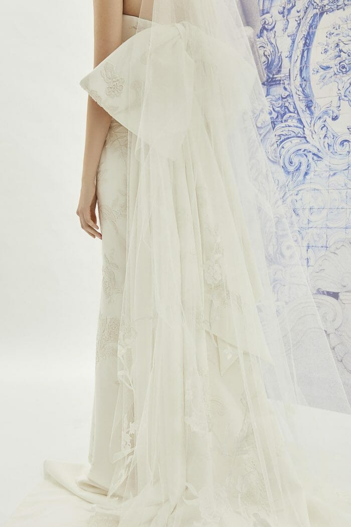 A Carolina Herrera strapless ivory crepe sheath wedding dress with a bow