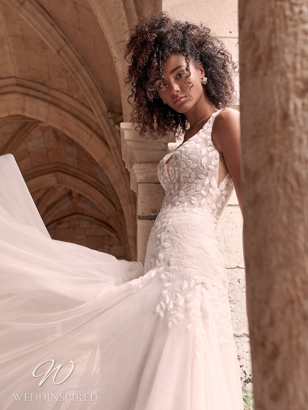 A Maggie Sottero Spring 2021 lace and tulle mermaid wedding dress with straps and a v neck