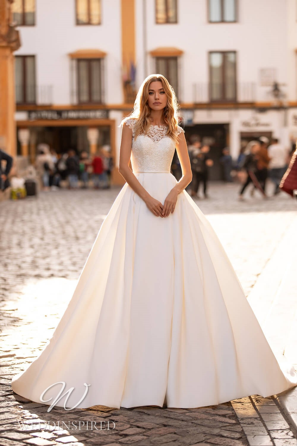 An Essential by Lussano 2021 lace and satin princess wedding dress with cap sleeves