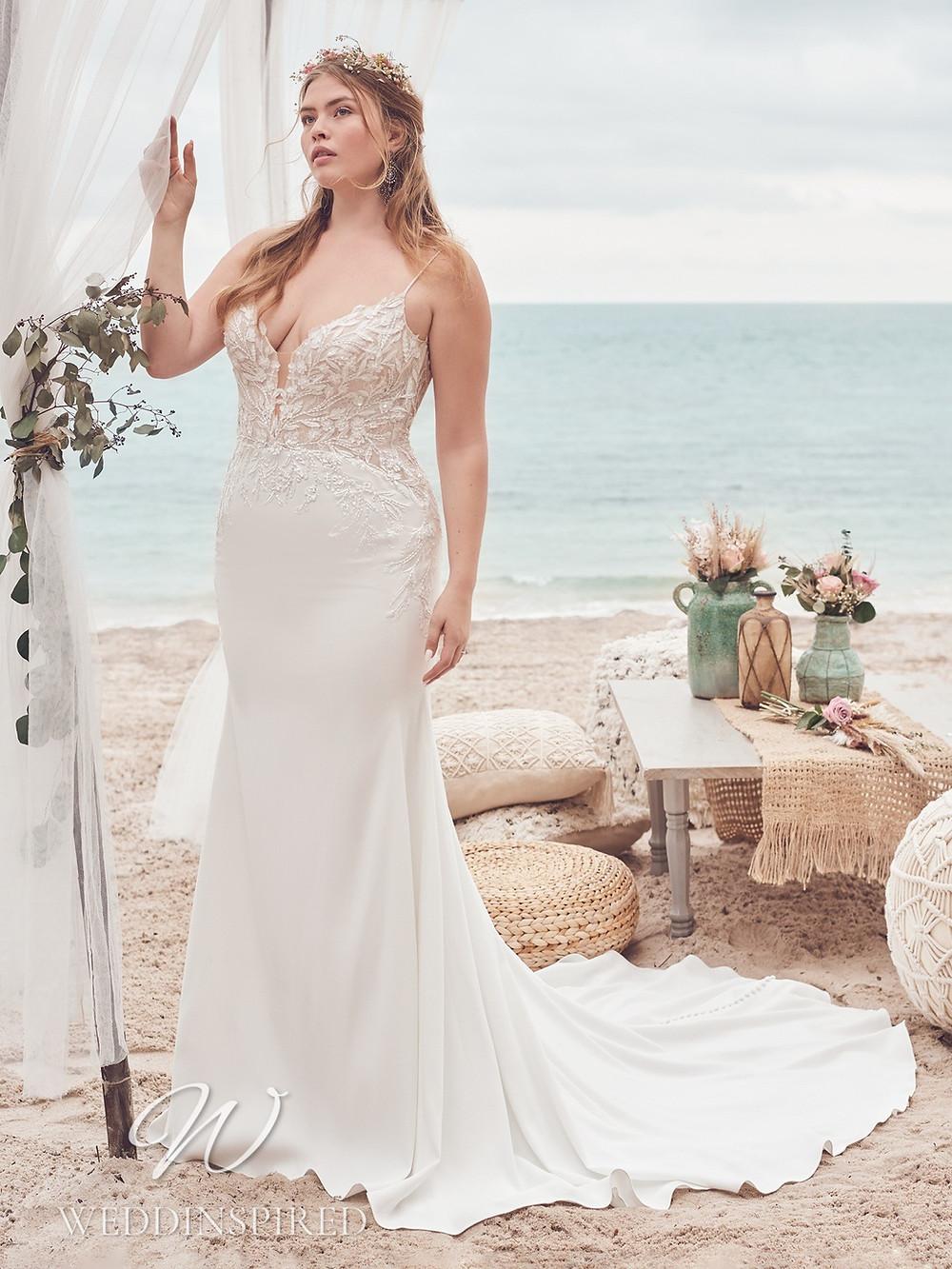 A Rebecca Ingram 2021 plus size lace and satin mermaid wedding dress