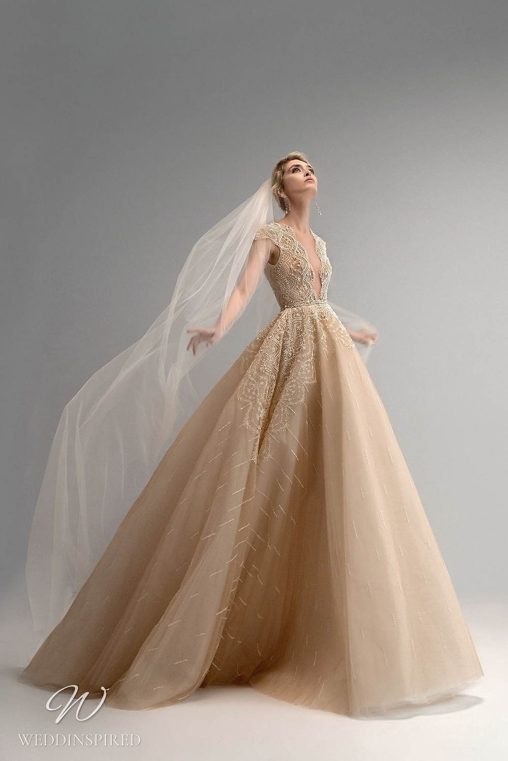 An Ersa Atelier 2021 gold ball gown wedding dress with a tulle skirt and a lace bodice with beading