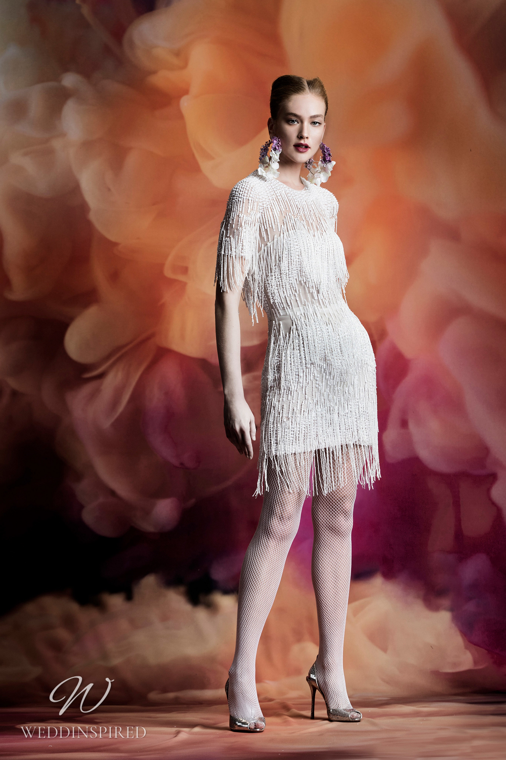 A Naeem Khan short wedding dress with fringe, cap sleeves and an illusion neckline