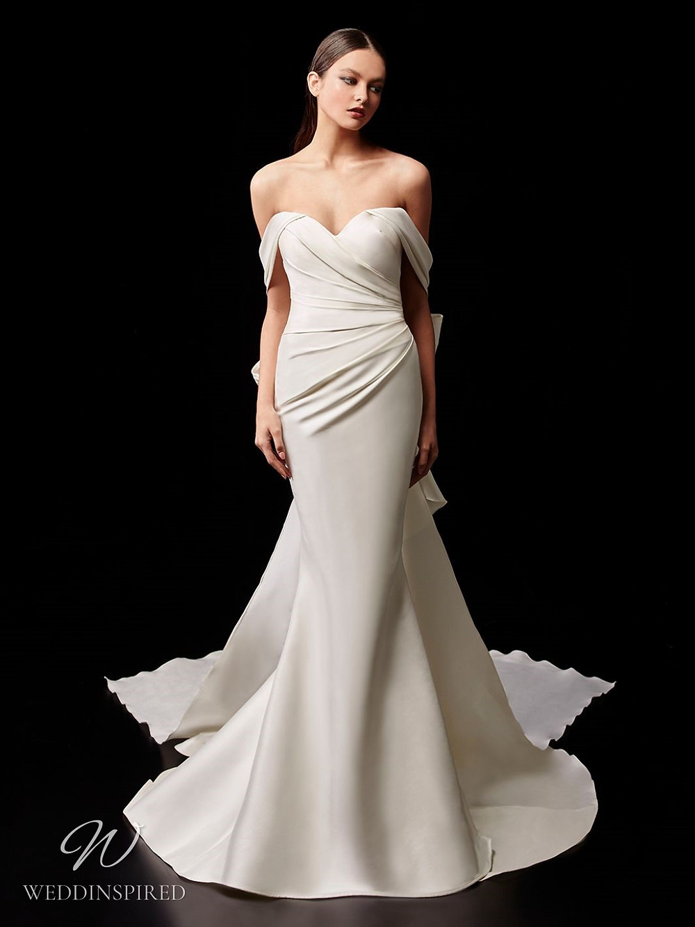 An Enzoani off the shoulder silk mermaid wedding dress with a cape