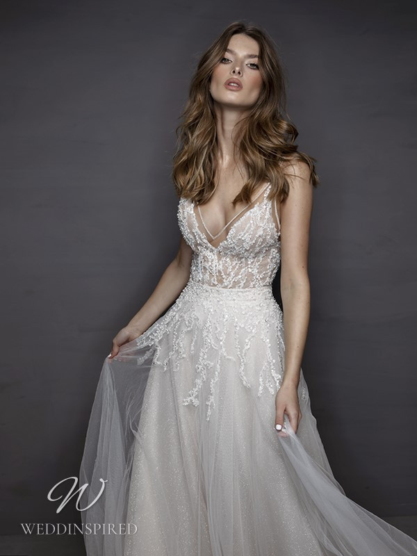 A Riki Dalal 2021 beaded tulle A-line wedding dress with a v neck