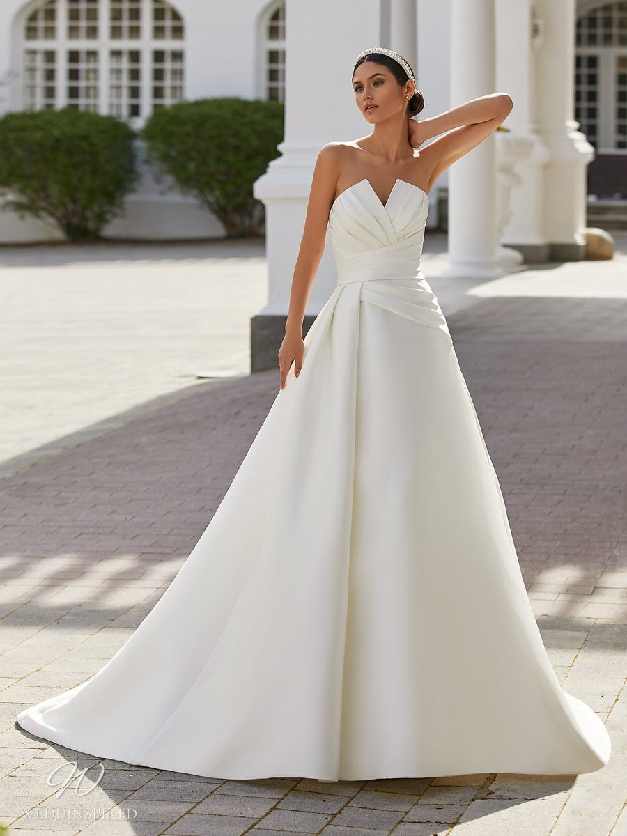 A Pronovias 2021 simple strapless silk ball gown wedding dress with pleats