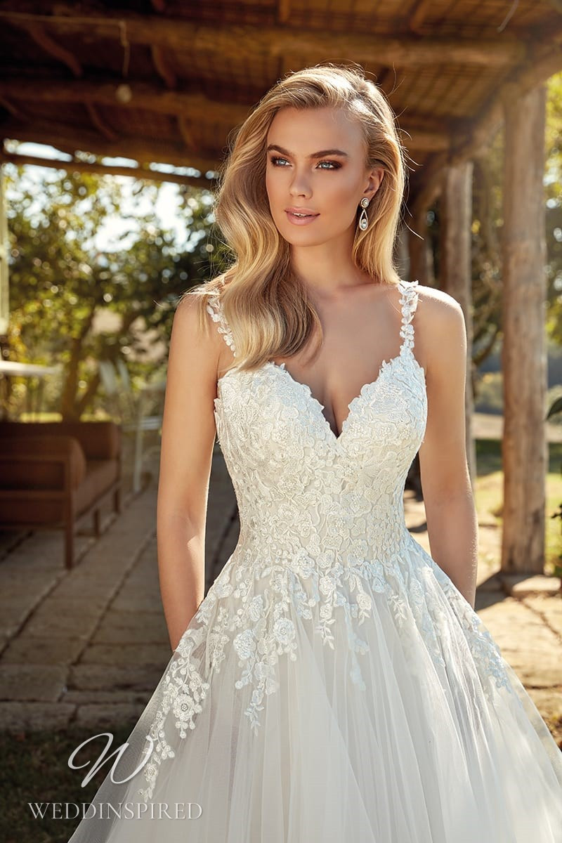 An Eddy K 2021 lace and tulle A-line wedding dress with pockets