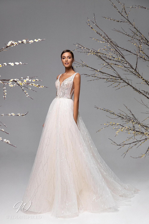 A Ricca Sposa blush sparkle mesh A-line wedding dress