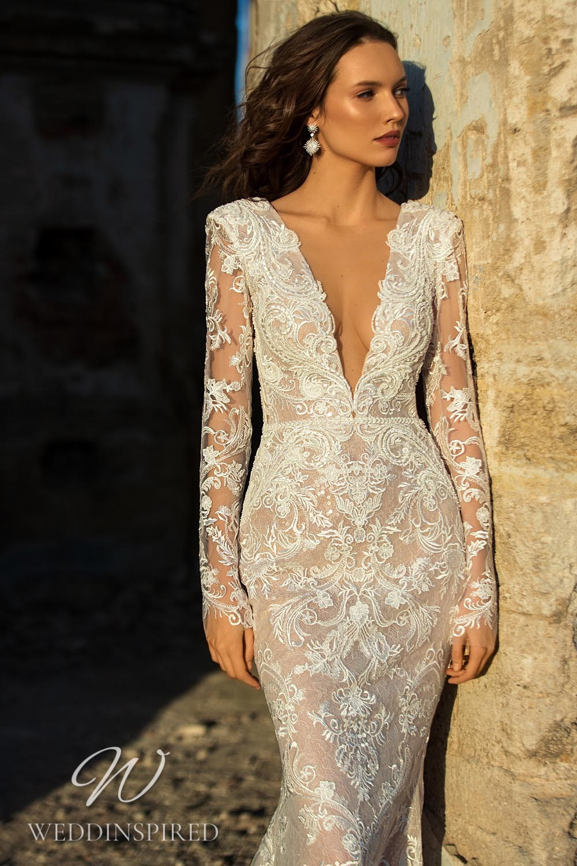 An Eva Lendel 2021 lace mermaid wedding dress with a v neck