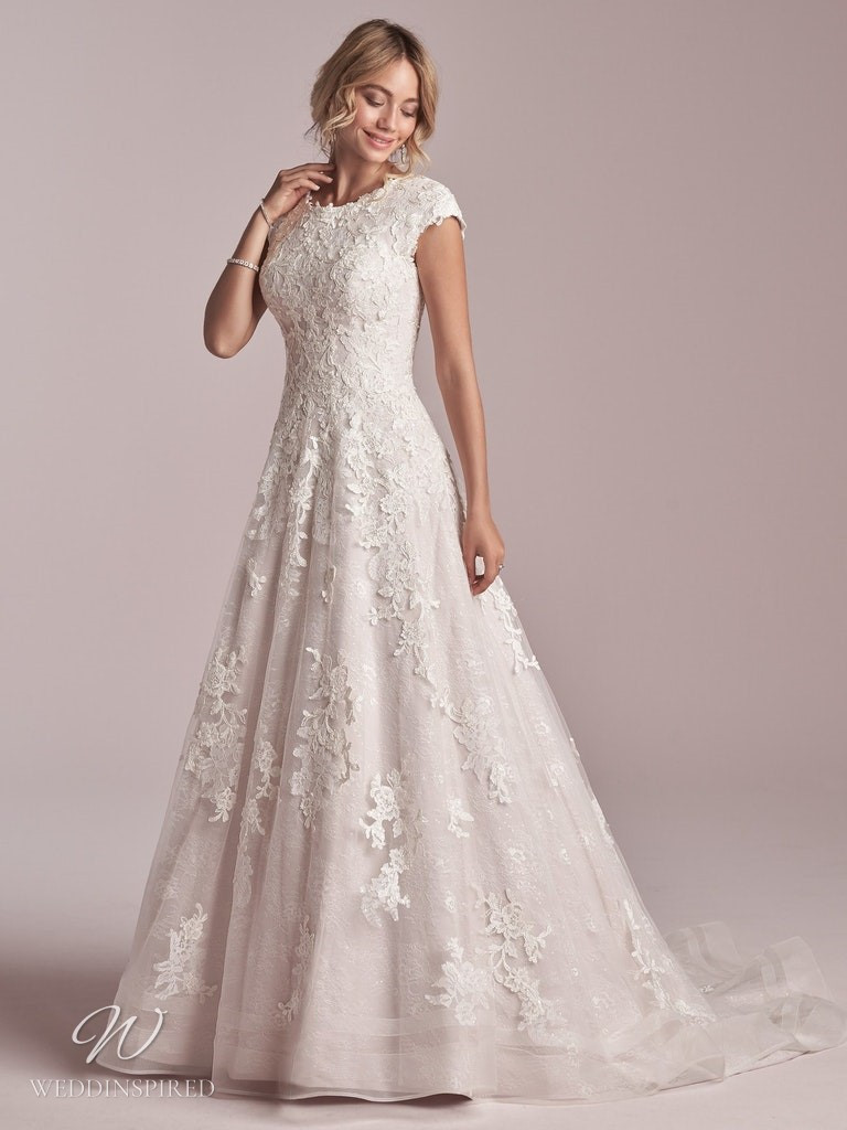A Rebecca Ingram 2020 modest lace A-line wedding dress with cap sleeves